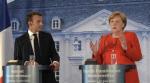 메르켈 마크롱, 난민 위기에 '유로존 공동 예산' 도입 합의